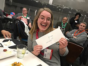 A photo of Becca and her prize...a $25 gift card to a local coffee shop.